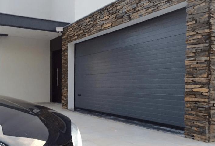 puerta seccional 706x480 - Puertas de Garaje Automaticas